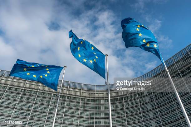european union flags at berlaymont building - democracy stock pictures, royalty-free photos & images