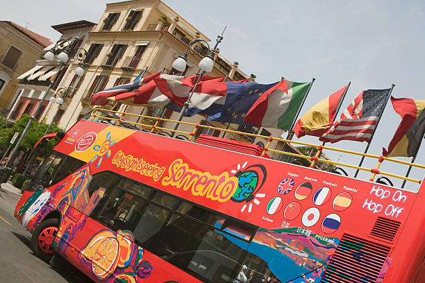 European union flags fluttering on a bus, Piazza Tasso, Sorrento, Naples Province, Campania, Italy
