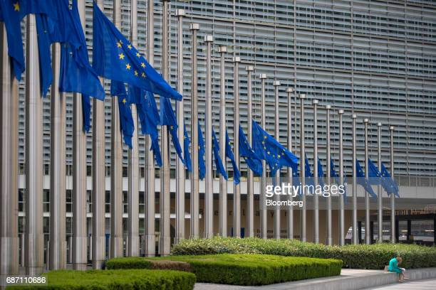 European Union flags fly at half mast following last night's terror attack Manchester UK outside the Berlaymont building in Brussels Belgium on...