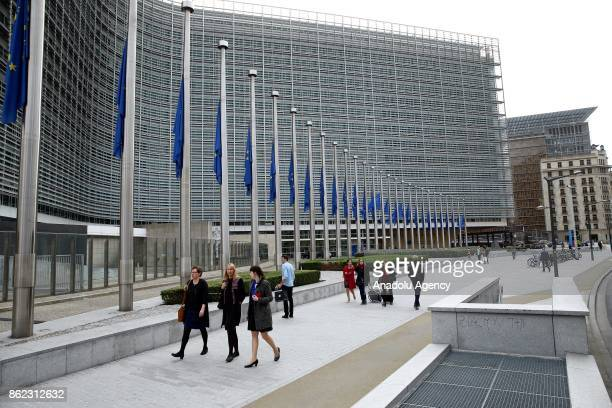 European Union flags fly at half mast in front of the Berlaymont Building in Brussels following forest fires in Portugal on October 17 2017 in...
