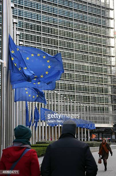 European Union flags fly at half mast in honour of former South African leader Nelson Mandela who died at the age of 95 last night outside the...