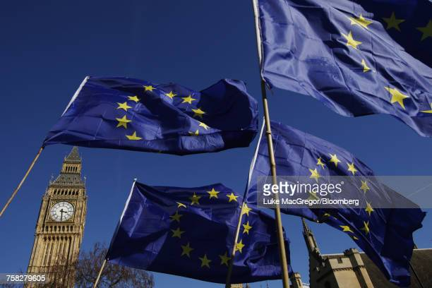 european union (eu) flags fly in front of big ben - big mac stock pictures, royalty-free photos & images