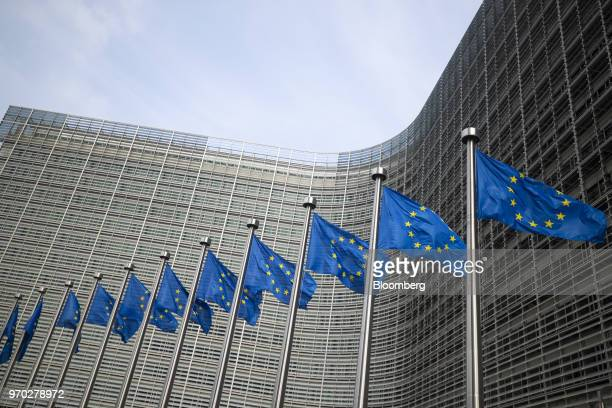 European Union flags fly in front of the European Commission Berlaymont building in Brussels Belgium on Friday June 8 2018 Chief negotiator for the...
