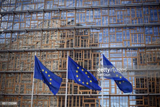 European Union flags fly outside a newly constructed part of the Europa building on March 10 2017 in Brussels Belgium EU leaders have gathered for a...