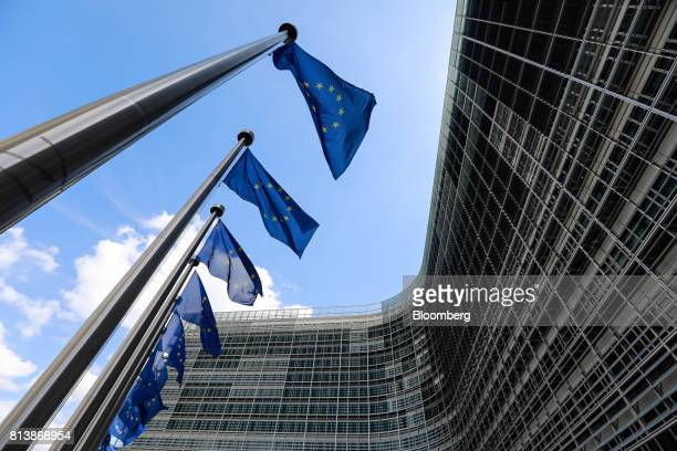 European Union flags fly outside the Berlaymont building in Brussels Belgium on Thursday July 13 2017 EU Chief Negotiator Michel Barnier yesterday...