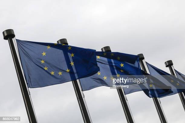 European Union flags fly outside the Berlaymont building in Brussels Belgium on Thursday Sept 28 2017 EU Chief Negotiator Michel Barnier said it will...