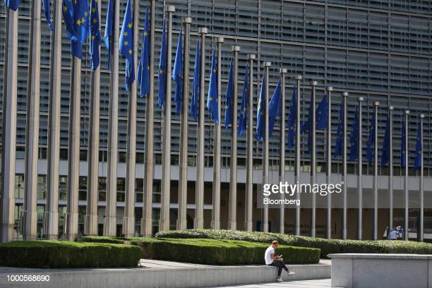European Union flags fly outside the Berlaymont building which houses the headquarters of the European Commission in Brussels Belgium on Monday July...
