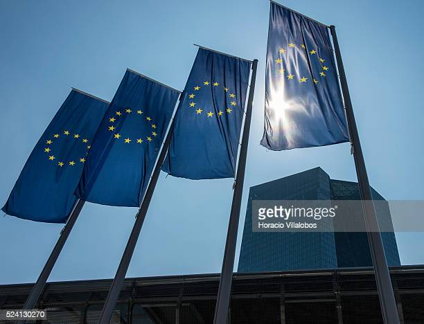 European Union flags outside the European Central Bank Headquarters in Frankfurt Germany 16 July 2015 on the day of its president Mario Draghi's...