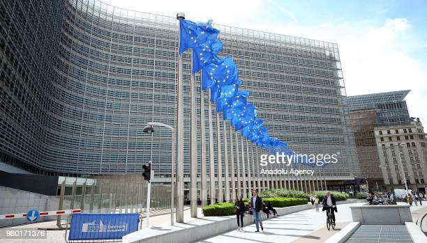 European Union flags wave in front of the Berlaymont Building in Brussels Belgium on June 21 2018