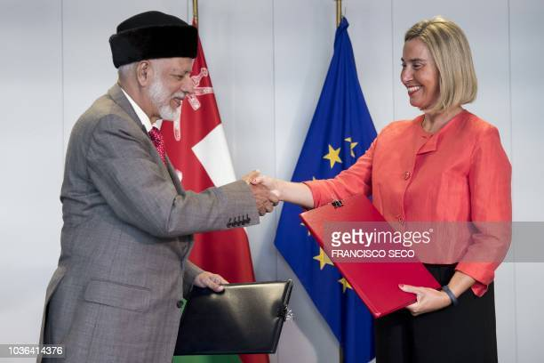 European Union Foreign Policy Chief Federica Mogherini and Omani Foreign Minister Yusuf bin Alawi bin Abdullah shake hands after signing an agreement...