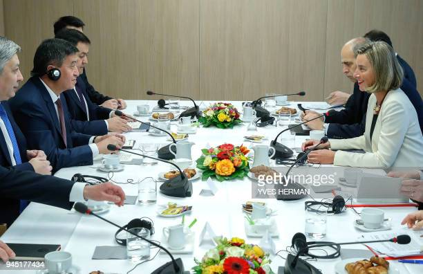 European Union foreign policy chief Federica Mogherini and Kyrgyzstan's President Sooronbay Jeenbekov attend a meeting in Brussels on April 12 2018 /...