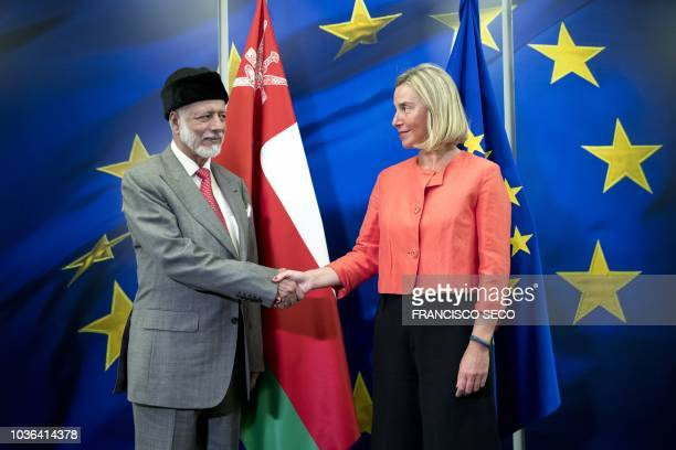 European Union Foreign Policy Chief Federica Mogherini shakes hands with Omani Foreign Minister Yusuf bin Alawi bin Abdullah before their meeting at...