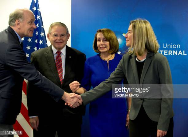 European Union foreign policy chief Federica Mogherini shakes hands with US Congressman Bill Keating eyed by United States Speaker of the House Nancy...