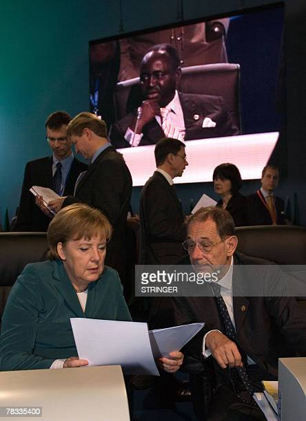European Union Foreign Policy Chief Javier Solana listens to Germany's Federal chancellor Angela Merkel during a EU Africa summit 08 December 2007 in...
