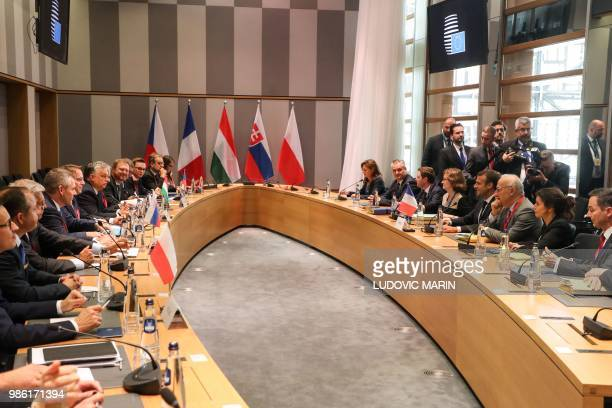 European Union leaders' attend a meeting of the Visegrad Group during an EU summit focused on migration Brexit and eurozone reforms on June 28 2018...