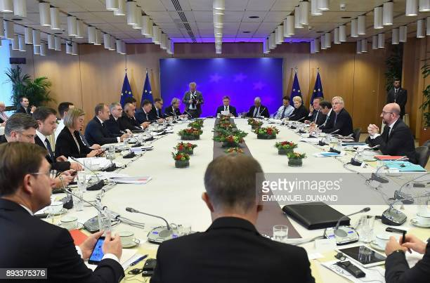 European Union leaders gather at the start of a meeting with EU's chief Brexit negotiator Michel Barnier on the second day of a European Union summit...