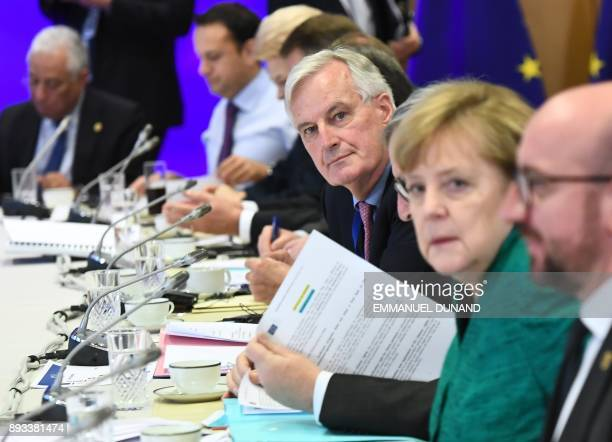 European Union leaders gather at the start of a meeting with EU's chief Brexit negotiator Michel Barnier and German Chancellor Angela Merkel on the...