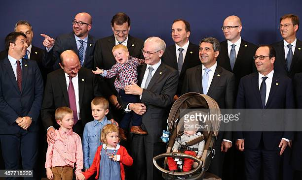 European Union leaders including the President of the European Council Herman Van Rompuy with his grandchildren pose for a family photograph at the...