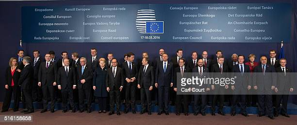 European Union leaders pose for a group photograph on the first day of an EU summit at the Council of the European Union on March 17 2016 in Brussels...