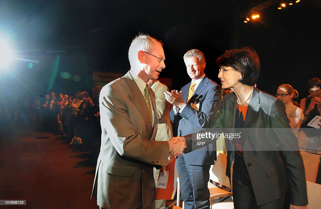 European Union President Herman Van Rompuy (L) is greeted by Flemish Christian Democrat party (CD&V) chairwoman Marianne Thyssen on May 22, 2010 at a party congress in Heverlee ahead of the June 13 general election. The government of Flemish Christian Democrat Yves Leterme fell in April 2010 after a key member of the five-party coalition, the Flemish liberal Open VLD walked out, frustrated over talks aimed at decreasing special rights for French speakers in Dutch-speaking Flanders.