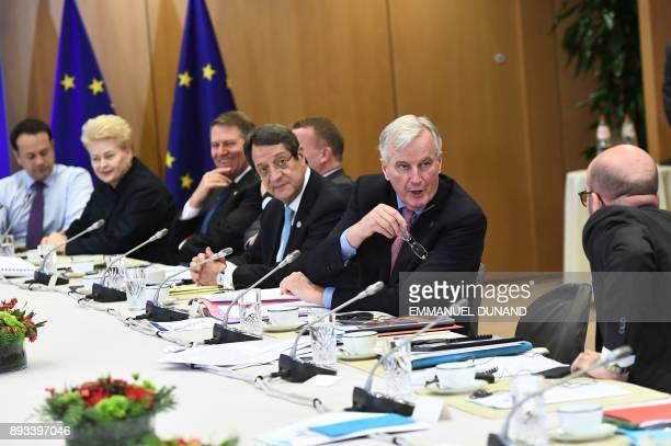 European Union's chief Brexit negotiator Michel Barnier Cyprus' President Nicos Anastasiades and EU leaders gather at the start of a meeting on the...