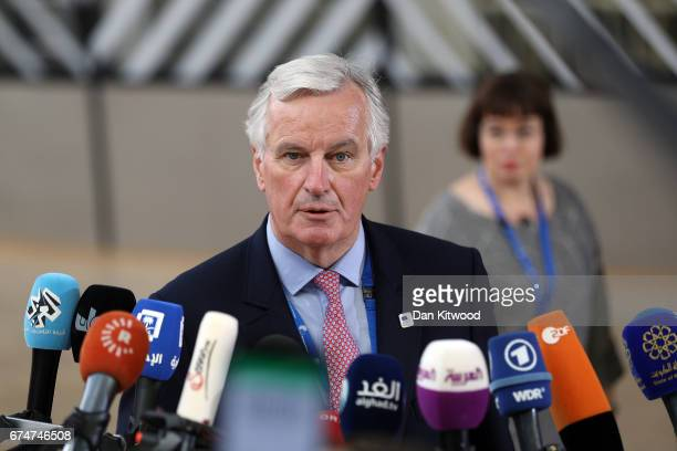 European Union's chief Brexit negotiator Michel Barnier speaks to the media as he arrives at the Council of the European Union ahead of an EU Council...
