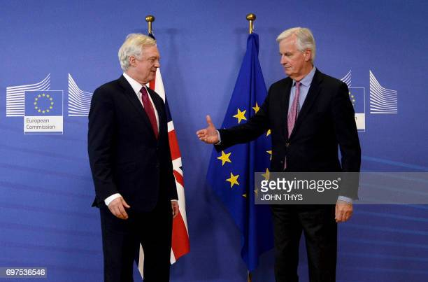 European Union's French chief Brexit negotiator Michel Barnier offers his hand to Britain's Secretary of State for Exiting the European Union David...