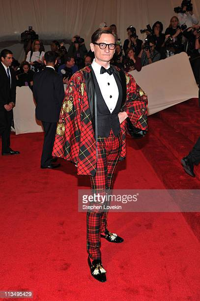 European Vogue editoratlarge Hamish Bowles attends the 'Alexander McQueen Savage Beauty' Costume Institute Gala at The Metropolitan Museum of Art on...