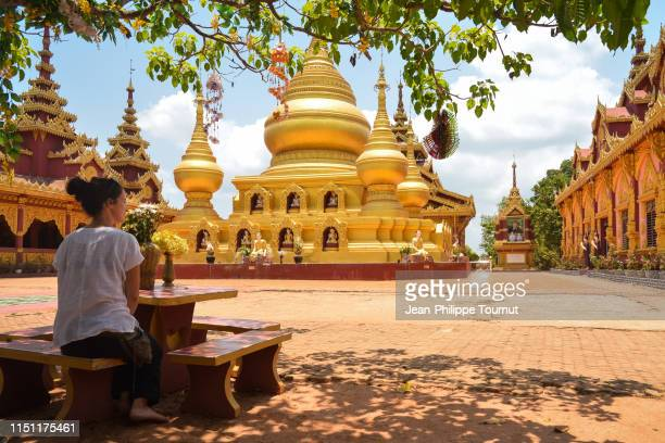 european woman relaxing in banana mountain monastery, southern myanmar, southeast asia - myanmar culture stock pictures, royalty-free photos & images