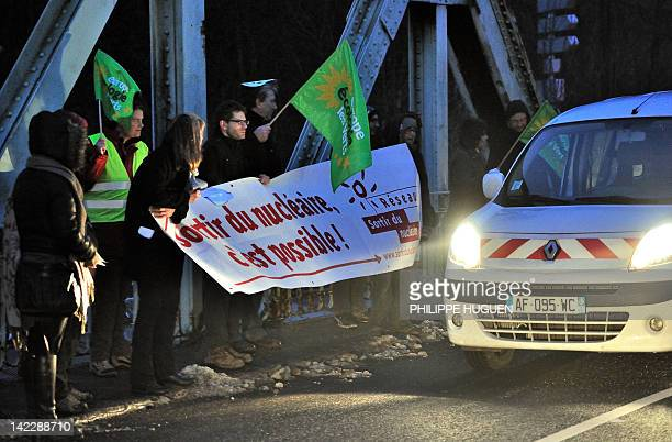 EuropeEcology supporters gather on a bridge on March 7 2012 in the eastern of Sequedin to protest against the radioactive waste convoy arriving from...