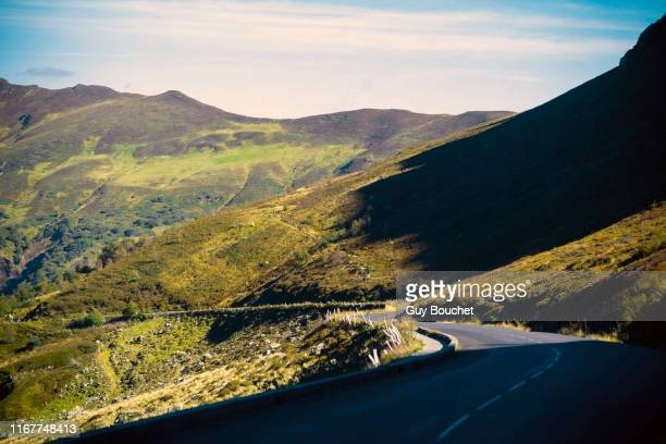 europe,france,auvergne-rhone-alpes, road from the puy mary - auvergne rhône alpes stock pictures, royalty-free photos & images