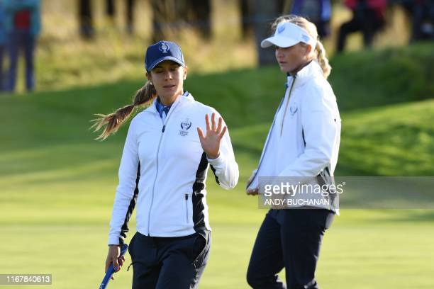 Europe's Azahara Munoz and Europe's Charley Hull walk on the 14th green on the first day of The Solheim Cup golf tournament at the Gleneagles Hotel...