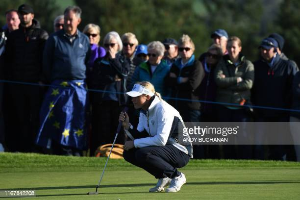Europe's Charley Hull lines up her putt on the 13th green on the first day of The Solheim Cup golf tournament at the Gleneagles Hotel in Gleneagles,...