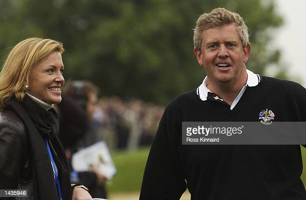 Europe's Colin Montgomerie of Scotland with his wife Eimear on the 15th green during the morning foursome matches on the second day of the 34th Ryder...