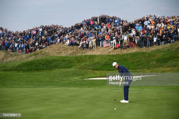 Europe's Danish golfer Thorbjorn Olesen plays a putt shot during his fourball match on the first day of the 42nd Ryder Cup at Le Golf National Course...