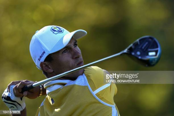 Europe's Danish golfer Thorbjorn Olesen plays a tee shot during a practice session ahead of the 42nd Ryder Cup at Le Golf National Course at...