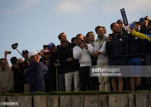 Europe's Danish golfer Thorbjorn Olesen plays a tee shot during his fourball match on the first day of the 42nd Ryder Cup at Le Golf National Course...