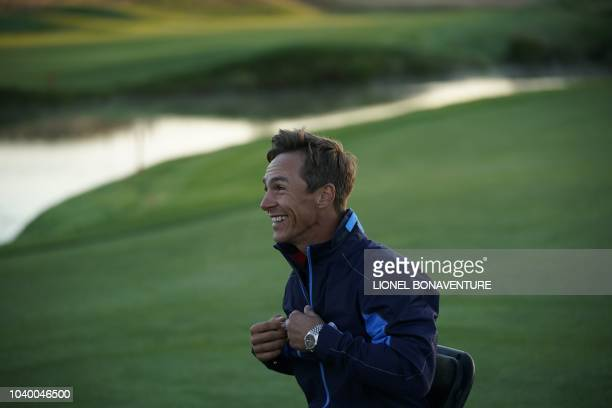 Europe's Danish golfer Thorbjorn Olesen poses after a group photograph ahead of the 42nd Ryder Cup at Le Golf National Course at...