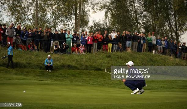 Europe's Danish golfer Thorbjorn Olesen reacts as he plays a putt shot during his fourball match on the first day of the 42nd Ryder Cup at Le Golf...