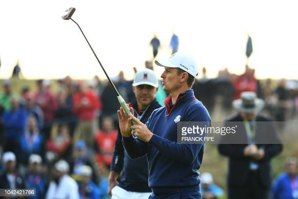 Europe's Danish golfer Thorbjorn Olesen reacts during his fourball match on the first day of the 42nd Ryder Cup at Le Golf National Course at...