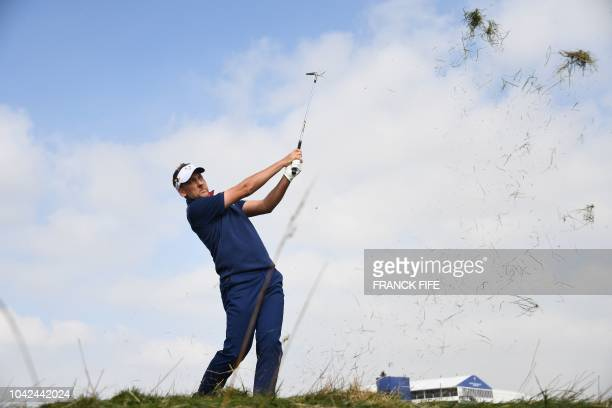 TOPSHOT Europe's English golfer Ian Poulter plays a fairway shot during his foursomes match on the first day of the 42nd Ryder Cup at Le Golf...