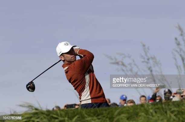 Europe's English golfer Paul Casey plays a tee shot during his fourball match on the second day of the 42nd Ryder Cup at Le Golf National Course at...