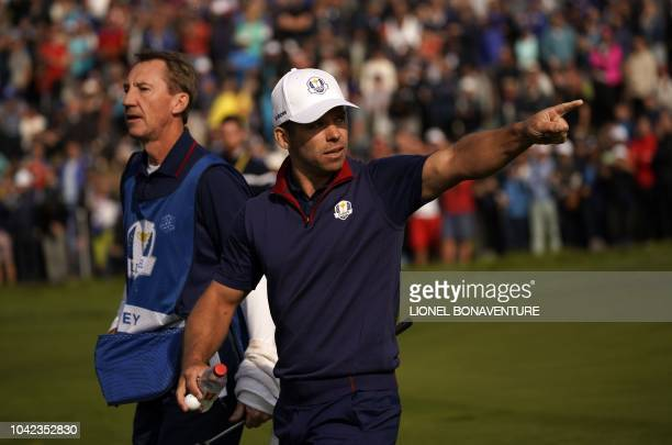 Europe's English golfer Paul Casey reacts after making a putt during his fourball match on the first day of the 42nd Ryder Cup at Le Golf National...