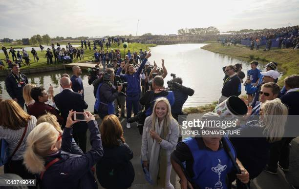 Europe's English golfer Tommy Fleetwood celebrates after Europe won the 42nd Ryder Cup at Le Golf National Course at SaintQuentinenYvelines southwest...