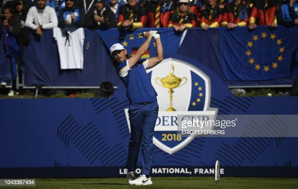Europe's English golfer Tommy Fleetwood plays a tee shot during his singles match with US golfer Tony Finau on the third day of the 42nd Ryder Cup at...