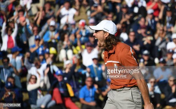 TOPSHOT Europe's English golfer Tommy Fleetwood reacts during his foursomes match on the second day of the 42nd Ryder Cup at Le Golf National Course...