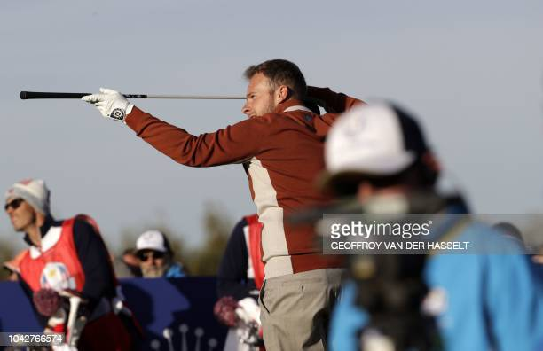 Europe's English golfer Tyrell Hatton eyes a shot during his fourball match on the second day of the 42nd Ryder Cup at Le Golf National Course at...