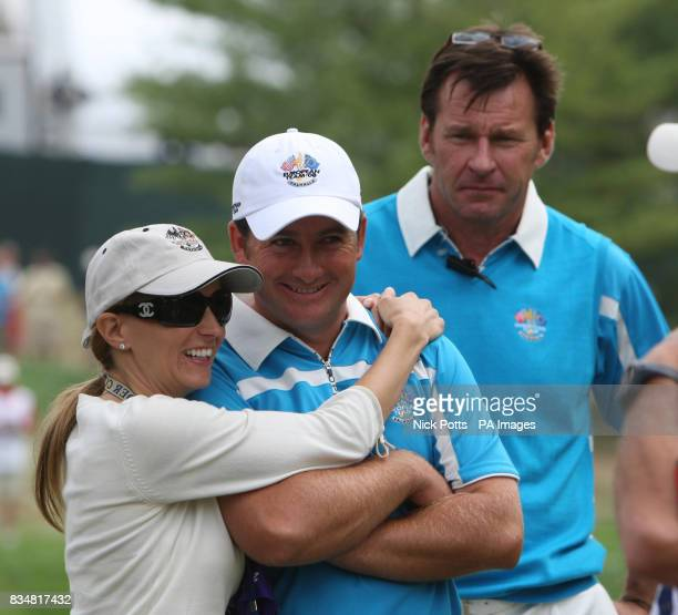 Europe's Graeme McDowell gets a hug from Katie Rose watched by Captain Nick Faldo during The Foursomes on Day Two at Valhalla Golf Club Louisville USA