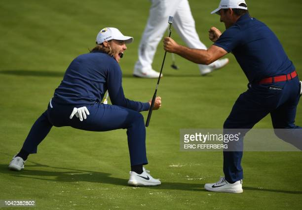 Europe's Italian golfer Francesco Molinari and Europe's English golfer Tommy Fleetwood celebrate their victory in their fourball match on the first...