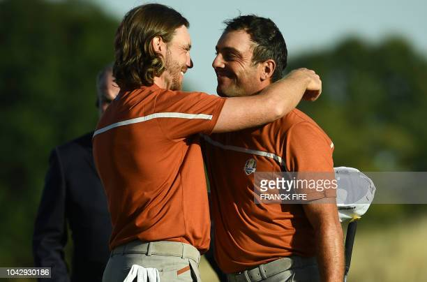 TOPSHOT Europe's Italian golfer Francesco Molinari and Europe's English golfer Tommy Fleetwood celebrate after winning their foursomes match on the...